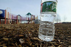 Disregarded water bottle found at Warminster community park, located at the former Naval Air Warfare Center Warminster, in Bucks County, Pennsylvania, USA  on February 6, 2019. The United States Environmental Protection Agency (EPA) is expected to release updates on tests of per- and polyfuoroalkyl substances or PFAs pollution in public water supplies for 16 million Americans in 33 states, including Pennsylvania. The federal report is delayed due to January 2019 shutdown. Reps. Brian Fitzpatrick, Republican of Bucks County in Eastern Pennsylvania and Democrat Dan Kildee, of Michigan cochair a bipartisan task force in the House of Representatives, formed to take on the growing PFAS Contamination Crisis. The usage of foam at nearby former military bases is linked to tainted drinking water, affecting tens of thousands of residents in Bucks and Montgomery Counties in Eastern Pennsylvania.