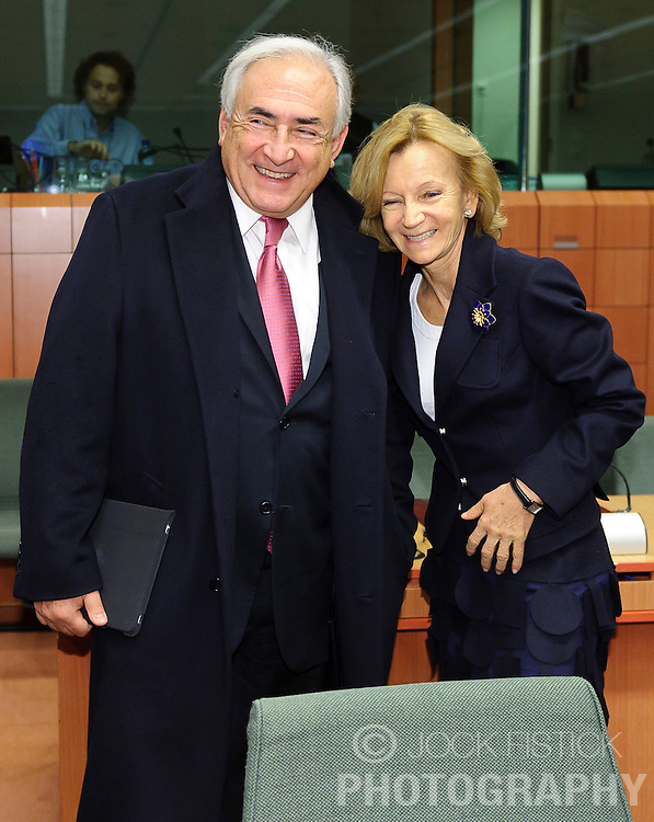 Dominique Strauss-Kahn, managing director of the IMF, left, is greeted by Elena Salgado, Spain's finance minister, during a meeting of the Eurogroup finance ministers at the EU Council headquarters in Brussels, Monday, Dec. 6, 2010. (Photo © Jock Fistick)