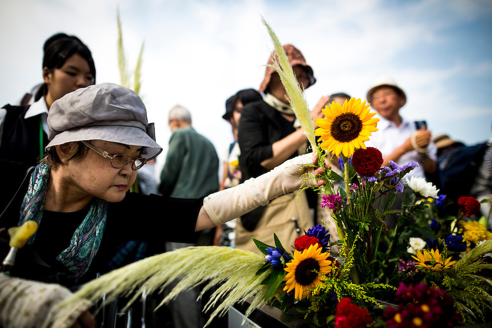 "HIROSHIMA, JAPAN - AUGUST 6 : Visitors lays flowers and pray for the atomic bomb victims in front of the cenotaph during the 71st anniversary of the atomic bombing on Hiroshima at Hiroshima Peace Memorial Park in Hiroshima, western Japan, Saturday, August 6, 2016. Japan marked the 71st anniversary of the atomic bombing on Hiroshima. On August 6, 1945, during World War II, the United States dropped a uranium gun-type atomic bomb named ""Little Boy"" on the city of Hiroshima which instantly killed an estimated 80,000 people, tens of thousands more would later die of radiation exposure. Three days later, a second American B-29 bomber dropped a plutonium implosion-type bomb ""Fat Man"" on Nagasaki, killing an estimated 40,000 people.  (Photo: Richard Atrero de Guzman/NURPhoto)"