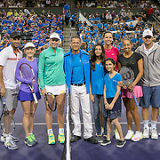 March 7, 2015, Indian Wells, California:<br /> Coin toss participants pose for a photograph with Joe Kiani, Founder and CEO of Masimo, during the McEnroe Challenge for Charity presented by Masimo in Stadium 2 at the Indian Wells Tennis Garden in Indian Wells, California Saturday, March 7, 2015. From left to right: John McEnroe, James Blake, Tracy Austin, Coco Vandeweghe, Joe Kiani (and children), Lindsay Davenport, Madison Keys, Rich Leach.<br /> (Photo by Billie Weiss/BNP Paribas Open)