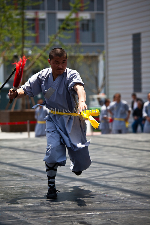 shaolin monks performing an athletic routine of kung fu