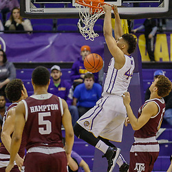 Feb 4, 2017; Baton Rouge, LA, USA; LSU Tigers forward Wayde Sims (44) dunks over Texas A&M Aggies guard Chris Collins (12) during the first half at the Pete Maravich Assembly Center. Mandatory Credit: Derick E. Hingle-USA TODAY Sports