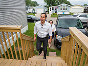 14 JUNE 2019 - WAUKEE, IOWA: JULIÁN CASTRO, Democratic presidential candidate and former Secretary of Housing and Urban Development during the Obama administration, walks into a home in Midwest County Estates, a mobile home community in Waukee, a Des Moines suburb, Friday. Castro met with residents of the community to talk about affordable housing. Mobile County Estates was sold in March and the new owners are trying to hike rents for lots in the community by 69%, an amount residents say they can't afford. Castro is visiting Iowa to support his candidacy for the Democratic ticket of the US Presidency. Iowa traditionally hosts the the first selection event of the presidential election cycle. The Iowa Caucuses will be on Feb. 3, 2020.                                  PHOTO BY JACK KURTZ