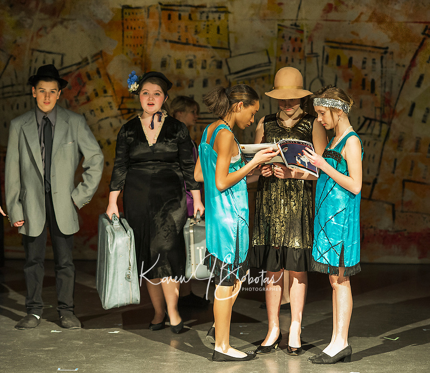 """Kate Persson at """"Millie"""" enters on cue during Laconia Middle School's production of Thoroughly Modern Millie, Jr Wednesday afternoon.  (Karen Bobotas/for the Laconia Daily Sun)"""
