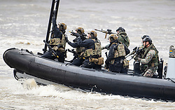 © Licensed to London News Pictures. 24/10/2018. London, UK. Armed Marines board a City Cruises boat ferry taken by hostages during the exercise. British Royal Marines are joined by the The Royal Netherlands Marines in a military demonstration at HNLMS Zeeland, which is anchored next to anchored next to HMS Belfast on the River Thames in central London. Members of the British and Dutch Royal families watched the event as part of a state visit to the UK. Photo credit: Ben Cawthra/LNP