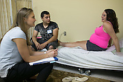 Salena Tubiolo, right, and Dan Rodriguez, both of Rochester, speak with physician assistant Kristin Fitzsimmons during a meeting at Centering Pregnancy in Rochester on Tuesday, July 14, 2015.