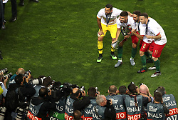 Portugal goalkeeper Rui Patricio (left), Ruben Neves, Joao Moutinho, and Diogo Jota (right) celebrate with the Nations League Trophy after the Nations League Final at Estadio do Dragao, Porto.