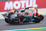 Rookie #20 Fabio Quatararo, French: Petronas Yamaha SRT passes former champion #99 Jorge Lorenzo, Spanish: Repsol Honda Team during racing on the Bugatti Circuit at Le Mans, Le Mans, France on 19 May 2019.