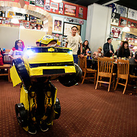 Ayden Martinez 7, transforming during a costume contest at Sammy C's Rockin Sports Pub & Grille on Halloween. Martinez won third  place in the costume contest as the transformer Bumblebee.