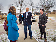 31 DECEMBER 2019 - ANKENY, IOWA: Sen US Senator CORY BOOKER (D-NJ) talks people on the sidewalk before a house party in Ankeny, a suburb of Des Moines. Sen Booker is campaigning in Iowa over New Years to support his candidacy for the US Presidency. Iowa traditionally holds the first event of the presidential election cycle. The Iowa caucuses are Feb. 3, 2020.       PHOTO BY JACK KURTZ