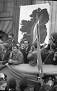 Sinn Fein (Provo) Dublin Parade.   K22..1976..25.04.1976..04.25.1976..25th April 1976..Sinn Fein held an Easter Rising Commemorative  parade..The parade started at St Stephens Green, Dublin and proceeded through the streets to the G.P.O.in O'Connell Street, the scene of the centre of the 1916 uprising..Image of the reviewing stand backed by the map of Ireland and the symbolized Easter Lily.