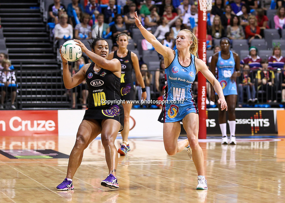 Waikato BOP Magic's Bessie Manu looks for a support playe under pressure from Southern Steel's Shannon Francois during the ANZ Netball Championship - Waikato BOP Magic v Southern Steel at Claudelands Arena, Hamilton on Monday 17 March 2014. Photo: Bruce Lim / www.photosport.co.nz