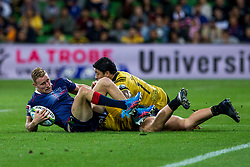 March 30, 2018 - Melbourne, VIC, U.S. - MELBOURNE, AUSTRALIA - MARCH 30 : Reece Hodge of the Melbourne Rebels  gets tackled by Ben Lam of the Wellington Hurricanes  and another Wellington Hurricanes player during Round 7 of the Super Rugby Series between the Melbourne Rebels and the Wellington Hurricanes on March 30, 2018, at AAMI Park in Melbourne, Australia. (Photo by Jason Heidrich/Icon Sportswire) (Credit Image: © Jason Heidrich/Icon SMI via ZUMA Press)