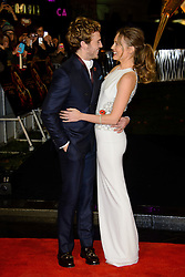 Sam Claflin and Laura Haddock at The World Premiere of 'The Hunger Games: Catching Fire'. Leicester Square, London, United Kingdom. Monday, 11th November 2013. Picture by Chris Joseph / i-Images