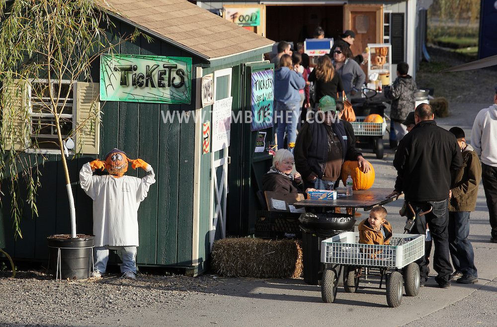 Middletown, New York - People buy tickets to enjoy games, a hayride to the pumpkin patch, the Petting Zoo, Haunted House and Hay Maze at Maples Farm and Garden Center on Oct. 23, 2011.