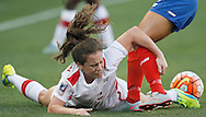Feb 19, 2016; Houston, TX, USA; Costa Rica forward Melissa Herrera (7) knocks down Canada defender Allysha Chapman (2)  from the ball in the first half during the semifinals of the 2016 CONCACAF women's Olympic soccer tournament at BBVA Compass Stadium. Mandatory Credit: Thomas B. Shea-USA TODAY Sports