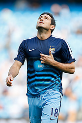 Frank Lampard of Manchester City takes to the pitch to warm up before facing his former club Chelsea - Photo mandatory by-line: Rogan Thomson/JMP - 07966 386802 - 21/08/2014 - SPORT - FOOTBALL - Manchester, England - Etihad Stadium - Manchester City v Chelsea FC - Barclays Premier League.