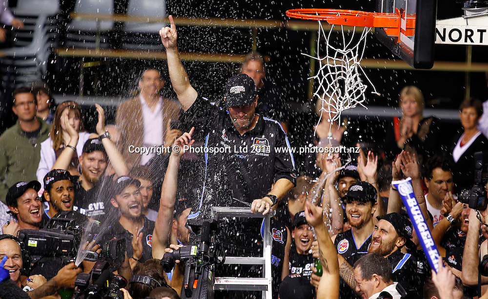 Breakers coach Andrej Lemanis celebrates after cutting the net during the ANBL Grand Finals Game 3, Burger King Breakers v Cairns Taipans at the North Shore Event Centre Auckland, New Zealand on Friday 29 April 2011. Photo: Simon Watts/photosport.co.nz