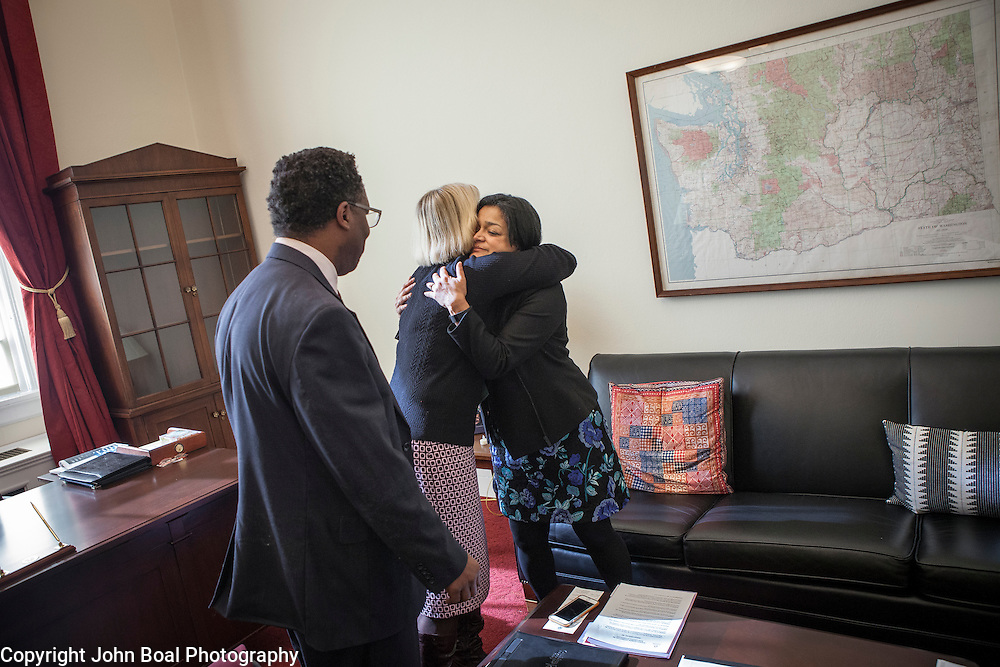 Representative Pramila Jayapal (D-WA, 7), right, finishes her first constituent meeting of the day, speaking to Mary Fertakis and -- of the Washington State School Directors Association, on Tuesday, January 31, 2017.  Among other topics of concern, they discussed the potential ramifications of President Trump's immigration and border security policies.  John Boal photo/for The Stranger