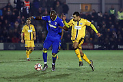 AFC Wimbledon striker Tom Elliott (9) battles for possesion with Sutton United midfielder Craig Eastmond (15) during the The FA Cup third round replay match between AFC Wimbledon and Sutton United at the Cherry Red Records Stadium, Kingston, England on 17 January 2017. Photo by Matthew Redman.
