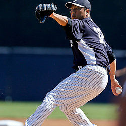 Mar 16, 2013; Tampa, FL, USA; New York Yankees starting pitcher Hiroki Kuroda (18) throws against the Philadelphia Phillies during the top of the first inning of a spring training game at George Steinbrenner Field. Mandatory Credit: Derick E. Hingle-USA TODAY Sports
