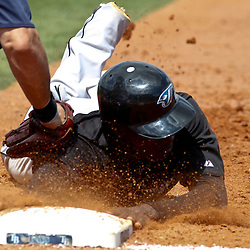 March 8, 2011; Port Charlotte, FL, USA; Toronto Blue Jays shortstop Adeiny Hechavarria (3) is tagged out by Tampa Bay Rays first baseman Casey Kotchman (23) during a spring training exhibition game at Charlotte Sports Park.   Mandatory Credit: Derick E. Hingle
