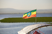 An Ethiopian flag on the front of a boat, lake Hawassa.