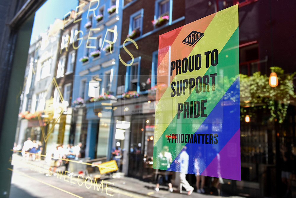 © Licensed to London News Pictures. 29/06/2018. LONDON, UK.  A Byron restaurant in Carnaby Street joins other stores in the Oxford Street area with a rainbow makeover in support of the Pride Festival, a worldwide celebration of the LGBT community.  The popular annual Pride London parade takes place in the capital on 7 July.  Photo credit: Stephen Chung/LNP