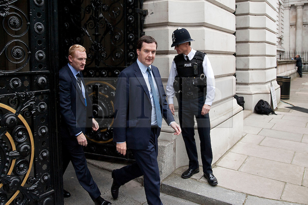 © Licensed to London News Pictures. 23/09/2013. London, UK. On the day of an emergency meeting of the COBRA committee to discuss the recent Kenyan terrorist attack George Osborne, the British Chancellor, is seen on Downing Street today (23/09/2013) with a British Army General. Photo credit: Matt Cetti-Roberts/LNP
