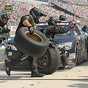 Kyle Busch (54) pit crew chances a set of tires during the NASCAR Nationwide Series 5-HOUR ENERGY 200 auto race at Dover International Speedway in Dover, DE., Saturday,  June 01, 2013.