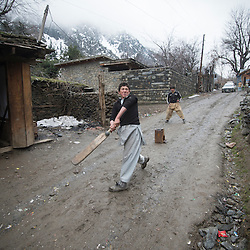 Bumburet, Chitral District,Pakistan.Pic Shows Kalash boys playing cricket in the Kalash village in the valley of Bumburet
