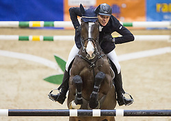 Gravemeier Hendrik of Germany with his horse Cortez 63 jumps during Equestrian competition  FEI Grand Prix World Cup Celje 2014, on November 30, 2014 in Equestrian Centre Celje, Slovenia. Photo by Vid Ponikvar / Sportida