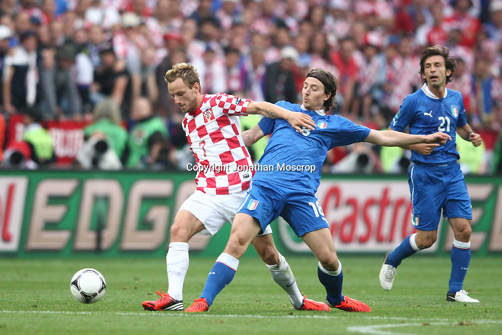 Jonathan Moscrop - LaPresse<br /> 14 06 2012 Poznan ( Polonia )<br /> Sport Calcio<br /> Europei 2012 Polonia e Ukraina - Italia vs. Croazia - Stadio Municipale di Poznan<br /> Nella foto: Riccardo Montolivo lotta con Ivan Rakitic<br /> <br /> Jonathan Moscrop - LaPresse<br /> 14 06 2012 Poznan ( Polonia )<br /> Sport Soccer<br /> Euro 2012 Poland and Ukraine - Italy versus Croatia - Municipal Stadium Poznan<br /> In the photo: Riccardo Montolivo clashes with Ivan Rakitic