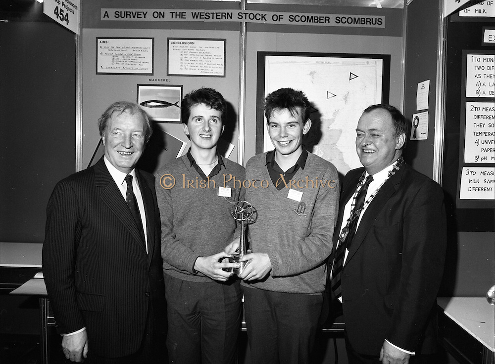 08/01/1988.01/08/1988.8th January 1988 .The Aer Lingus Young Scientist of the Year Award at the RDS, Dublin..Picture shows (L-R) the Taoiseach Charles Haughey, T.D., Kevin Mc Cauley, Fergal Mc Aleavey, both from Abbey Vocational School, Donegal Town whose project 'A Survey of the Western Stock of Scomber Scombrus' won the Best Group and Michael Hanley, President of the Teachers Union of Ireland.