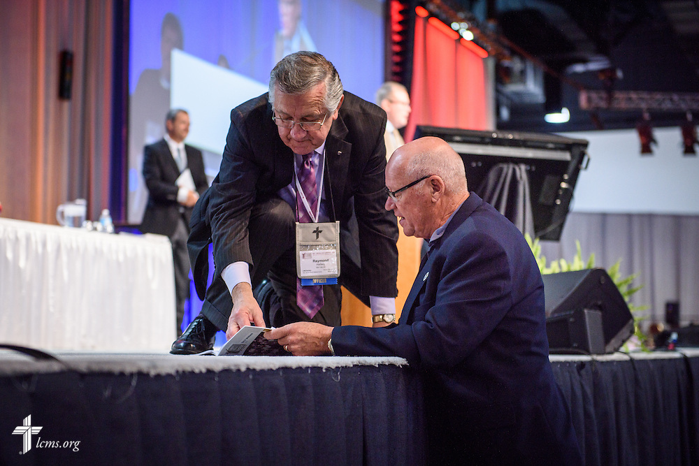 The Rev. Dr. Raymond L. Hartwig, works with a delegate during the 66th Regular Convention of The Lutheran Church–Missouri Synod on Thursday, July 14, 2016, in Milwaukee. Hartwig was recognized for his 18 years of service. He was first elected as the Synod's secretary in 1998 and has since served six consecutive three-year terms under four different LCMS presidents.  LCMS/Frank Kohn