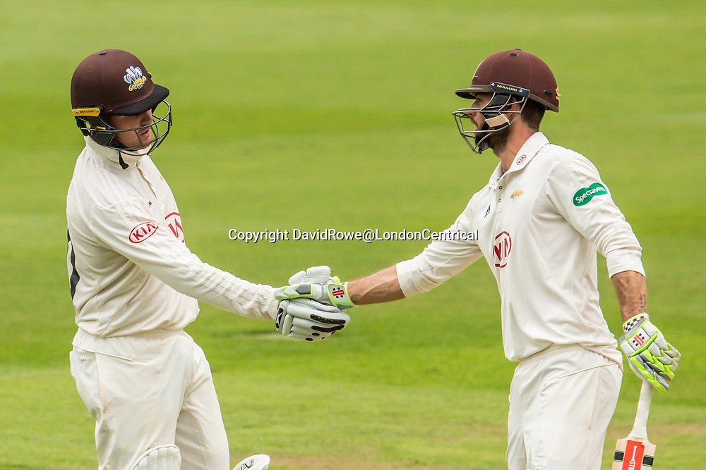 London,UK. 29 August 2017. Jason Roy is congratulated by Ben Foakes after reaching his fifty batting for Surrey against Middlesex at the Oval on day two of the Specsaver County Championship match at the Oval. David Rowe/ Alamy Live News