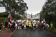 Members and supporters of Auckland Iwi march toward central Auckland in a Hikoi to protest the New Zealand government's plan to create an Auckland Supercity without Maori consultation and representation.<br />