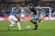 Sheffield Wednesday striker Atdhe Nuhiu and Queens Park Rangers defender Grant Hall during the Sky Bet Championship match between Queens Park Rangers and Sheffield Wednesday at the Loftus Road Stadium, London, England on 20 October 2015. Photo by Jemma Phillips.