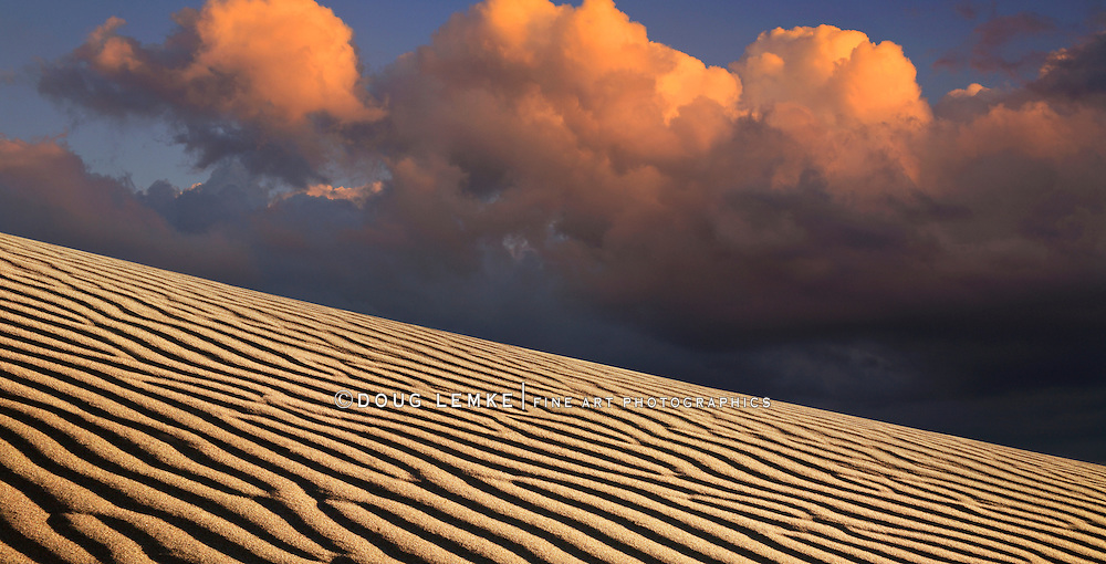 Sand Ripples And A Stormy Cloudscape At Evening Time In Death Valley National Park, California, USA