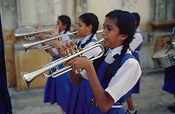 School girls playing trumpets in school band; in Cochin; Kerala; India,