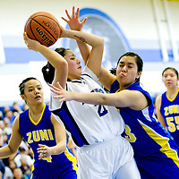 030113  Adron Gardner/Independent<br /> <br /> Navajo Pine Warrior Kaitlin Chee (21), center, is pressured by Zuni Thunderbird Alissa Paquin (23), right, during the 1-2A district final in Navajo March, 1.