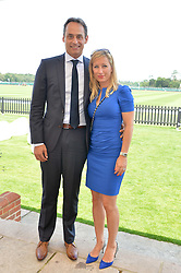 ANDRE KONSBRUCK Director of Audi UK and CHRISTINE SIEG at the Audi International Polo at Guards Polo Club, Windsor Great Park, Egham, Surrey on 26th July 2014.