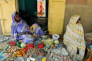 Women selling locally grown fruits and vegetables in the Kankossa town market. The Sahel stretches across Africa from the Atlantic Ocean to the Red Sea. It is a semi-arid, Eco-climatic, bio-geographical transition zone between the Sahara Desert to the north and the savanna regions to the south. It is in these climatic and bio-geographical transition zones where the affects of global warming and climate change are most felt. Just a couple of decades ago, Mauritania's population was largely nomadic herdsmen. While they remain highly mobile, Mauritanians have become increasingly sedentary, relying on agriculture and livestock for their livelihoods. Erratic rainfall and prolonged, severe drought caused by climate change have plagued the Sahel in recent years with serious consequences for local populations.<br />
