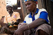 Fajima Yakaba, 12, (left) helps her aunt prepare dinner after getting back from school  in the village of Chaalam, Ghana on Tuesday June 5, 2007.