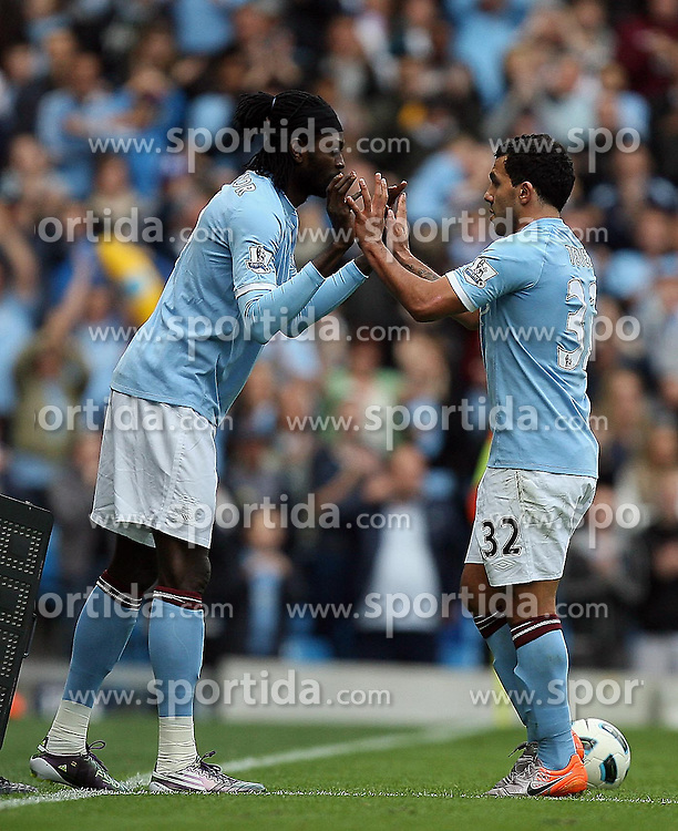 25.09.2010, City of Manchester Stadium, Manchester, ENG, PL, Manchester City vs Chelsea FC, im Bild Manchester City's Carlos Tevez is substitures , here with Manchester City's Emmanuel Adebayor, EXPA Pictures © 2010, PhotoCredit: EXPA/ IPS/ M. Atkins *** ATTENTION *** UK AND FRANCE OUT! / SPORTIDA PHOTO AGENCY