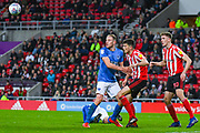 Tom Flanagan of Sunderland (12) and Matthew Clarke of Portsmouth (5) in action during the EFL Sky Bet League 1 first leg Play Off match between Sunderland and Portsmouth at the Stadium Of Light, Sunderland, England on 11 May 2019.