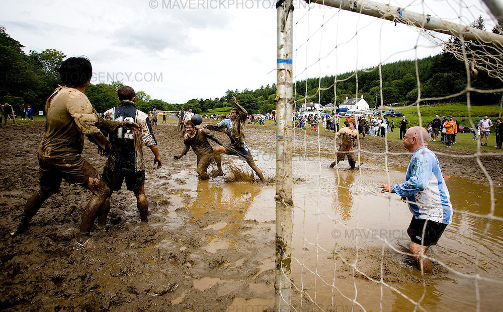 Men Swamp footballers in action at the 3rd Swamp Soccer New World Championships in Strachur, Argyll. Scotland.