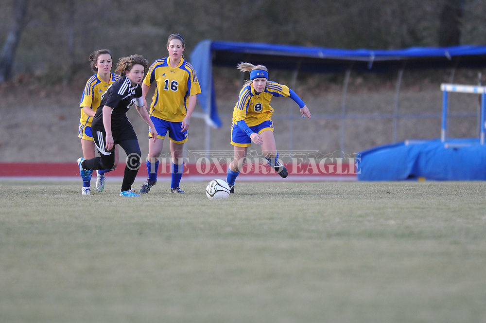 Oxford's Cari Hansen (8) vs. New Hope's Effie Morrison (17) in girls high school soccer action at Oxford High School in Oxford, Miss. on Wednesday, January 26, 2011. New Hope won 3-2 in overtime in the MHSAA Class 5A playoff match.