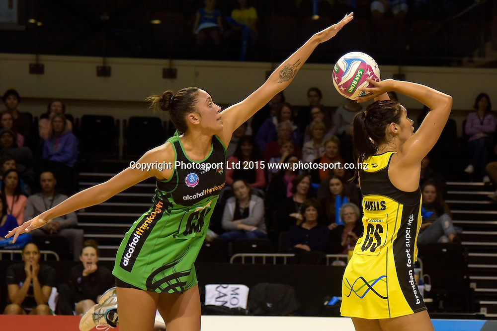 Fever's Natalie Medhurst (L) blocks Pulse's Ameliaranne Wells as she shoots a goal during the ANZ Championship - Pulse v Fever netball match at the TSB Arena in Wellington on Monday the 19th of April 2015. Photo by Marty Melville / www.Photosport.co.nz