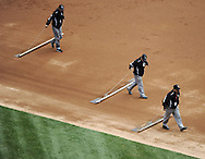 CHICAGO - APRIL 24:  The White Sox ground crew rake the field between innings of the game between the Chicago White Sox and Cleveland Indians on April 24, 2013 at U.S. Cellular Field in Chicago, Illinois.  The White Sox defeated the Indians 3-2.  (Photo by Ron Vesely/MLB Photos via Getty Images)